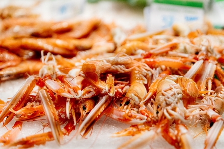 Fresh raw lobsters on ice. Fish and seafood market