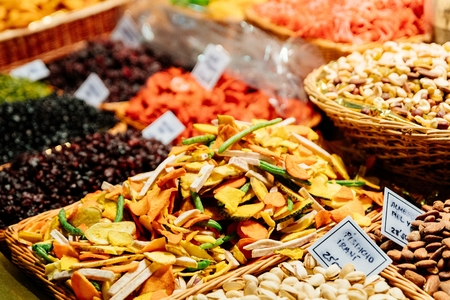 Dried fruits, pistachio nuts and other fruits and vegetables on market stall
