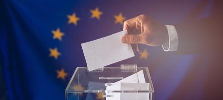 Man throwing his vote into the ballot box. EU elections. Elections to the European Parliament Banco de Imagens