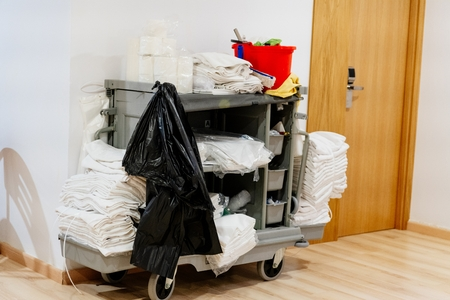 Hotel room maid trolley with towels and cleaning detergents Banco de Imagens