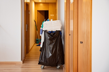 Room maid trolley with towels and cleaning dete