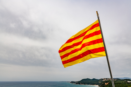 Red and yellow stripes Catalonia flag waving on the wind