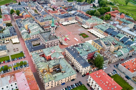 Drone view on Zamosc old town and city main square with town hall. Zamosc is a city in southeastern Poland, situated in the southern part of Lublin Voivodeship. Zamosc, Poland, Europe