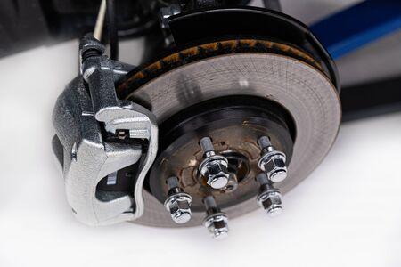 Car braking disc and suspension. Car service