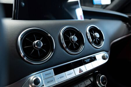 Car air vents and air conditioner control panel. Modern car interior