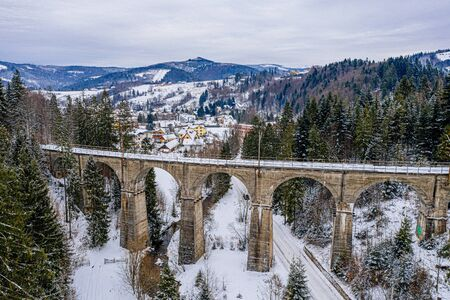 Aerial drone view on railway viaduct at winter. Wisla, Silesian Beskid, Poland
