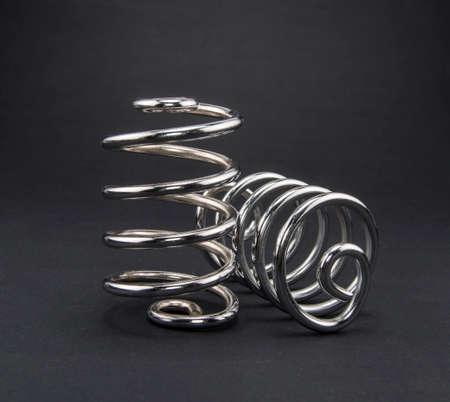 two metal steel springs on black background Stock Photo
