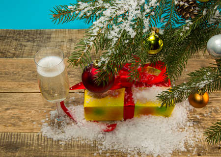 bough: gift under the Christmas tree on a wooden background