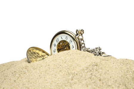 Pocket watch in the sand on a white background Stock Photo