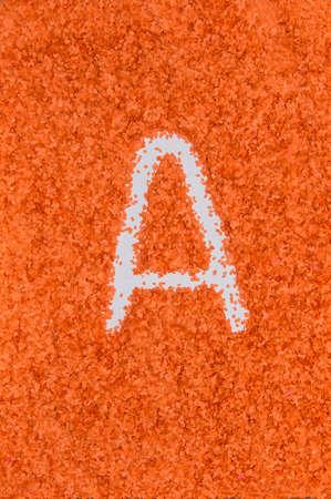Letter A of sliced orange paper, alphabet Stock Photo