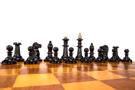 battle plan: black chess pieces on the board Stock Photo