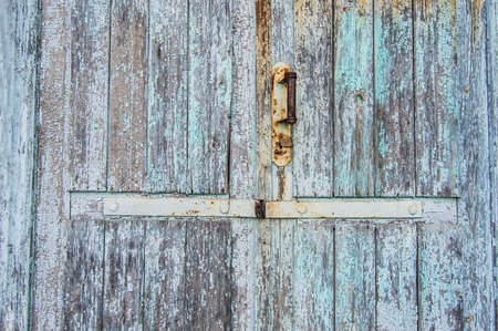 old wooden door, peeling off paint