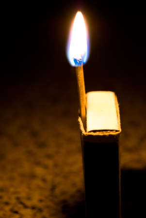 Close up of a burning match photo