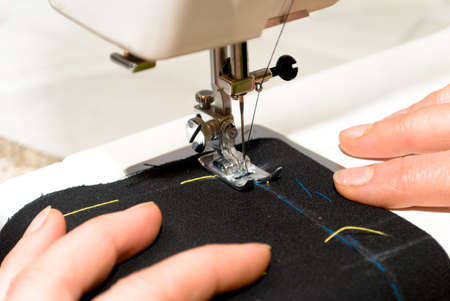 Hand sewing on a machine Stock Photo - 5114616