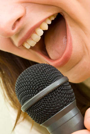 solo: Singing Microphone Girl Stock Photo