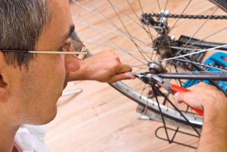 service for bike with adept repairing bike photo
