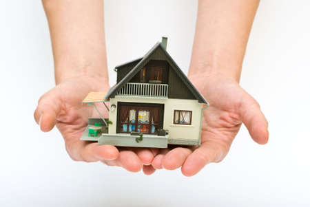 The house in human hands Stock Photo - 5400605