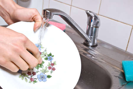 Washing plate in the kitchen Stock Photo - 5558513