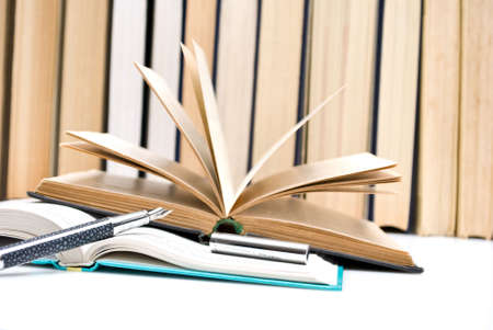 pen and  open book photo