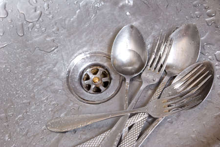 wash the forks and spoons photo