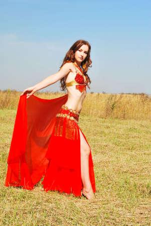 costume jewelry:  Attractive girl dances east dance Stock Photo