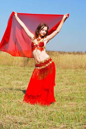Attractive girl dances east dance photo