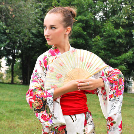 caucasian model dressed up in traditional japanese clothing photo