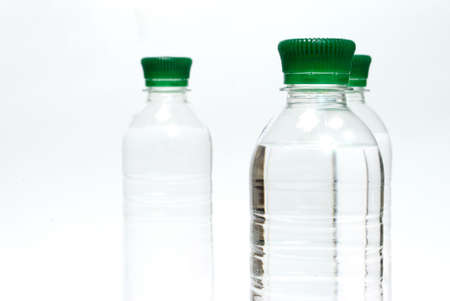 Plastic bottles of mineral water isolated on  the white background photo