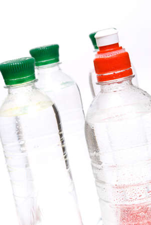 Plastic bottles of mineral water isolated on white background photo