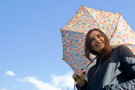 Picture of a young happy smiling girl standing under the rain with umbrella Stock Photo - 5706782