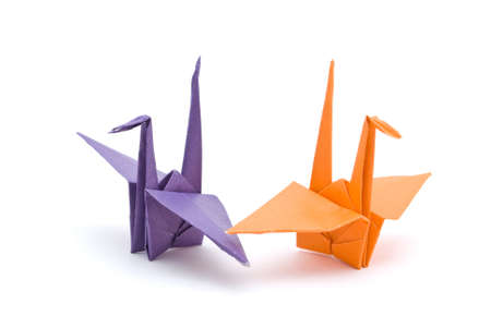 crane origami:  origami birds on a white background