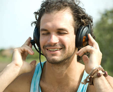Portrait of young man with headphones photo