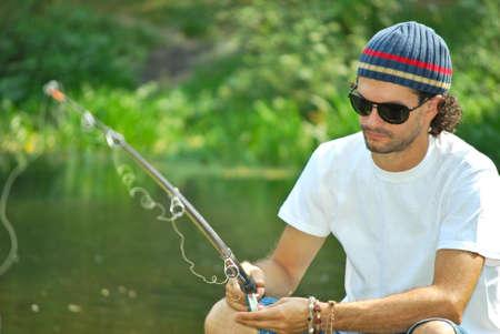 hombre pescando: hombre de pesca