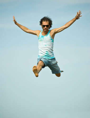 Man jumping on sky background photo