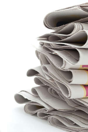 Stack of newspaper on white background close up photo