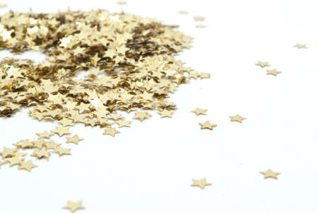 new year eve confetti: close up of confetti on white background