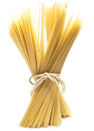 penne: spaghetti, standing against a white background