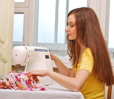 Woman seamstress work on the sewing-machine Stock Photo - 9367121