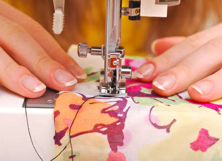 Hand sewing on a machine photo