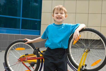 Boy and bicycle photo