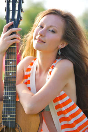 Young woman with guitar Stock Photo - 10417939