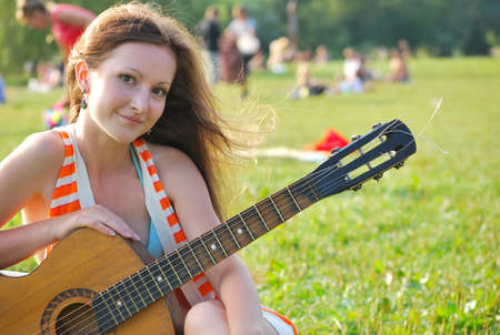 Young woman with guitar Stock Photo - 10417938