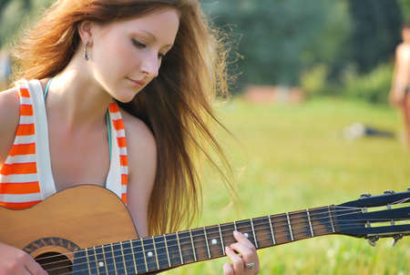 Young woman with guitar photo