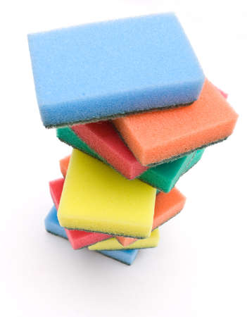 Brightly colored sponges on white background  photo