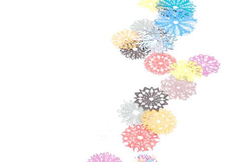 Origami snowflakes on the white background photo