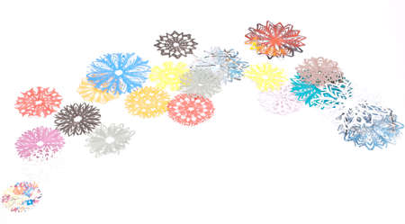Origami snowflakes on the white background photo