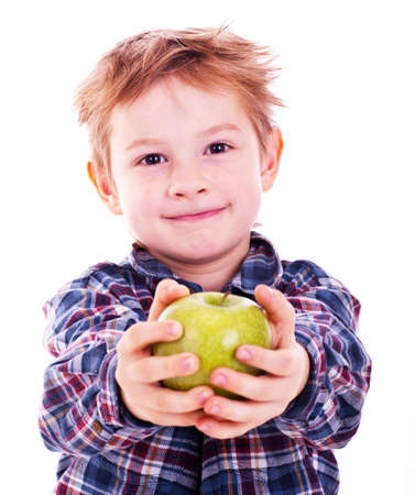 candid: Little boy with apple. Isolated on white background.