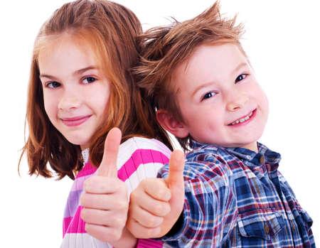 niño modelo: Niño feliz y pulgares chica Foto de archivo