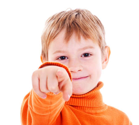 boy pointing with finger against a white background photo