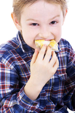 Boy eating healthy sandwich on white background photo